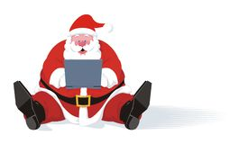 Santa Claus Typing his Laptop Stock Photo