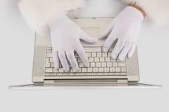Santa claus typing on laptop Stock Images