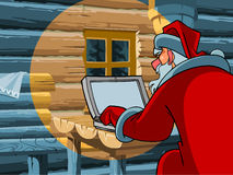 Santa Claus typing a letter on the computer Stock Image