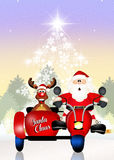 Santa Claus uma rena no side-car Fotos de Stock Royalty Free