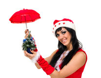 Santa claus with an umbrella and Christmas Royalty Free Stock Photography
