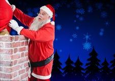Santa Claus umieszcza jego prezenta worek w komin Obraz Stock