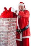 Santa Claus umieszcza prezenta pudełko w komin Zdjęcia Royalty Free