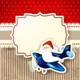 Santa Claus und das Flugzeug über rotem Hintergrund Stockfotos