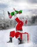 Santa Claus und kleine Elfe Lizenzfreies Stockbild