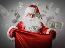 Santa Claus und Sack mit Dollar Stockbild