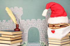 Santa Claus. Unusual Santa Claus from books before blackboard with drawing chalk of castle Stock Images