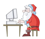 Santa Claus use computer Stock Photo