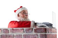Santa Claus Using Laptop Royaltyfri Bild