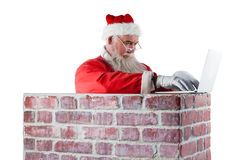 Santa Claus Using Laptop Royaltyfri Fotografi