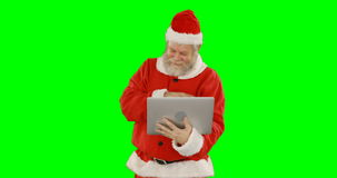 Santa Claus Using Laptop lager videofilmer