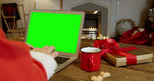 Santa claus using laptop. During christmas time at home stock video