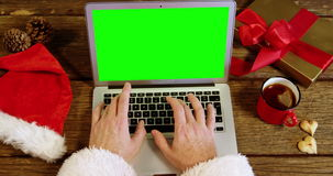 Santa claus using laptop. During christmas time at home stock footage