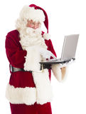 Santa Claus Using Laptop Royalty Free Stock Photos