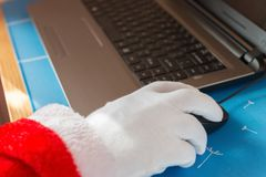 Santa claus using mouse Royalty Free Stock Photography