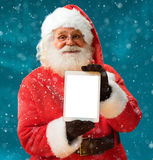 Santa Claus using tablet computer Stock Images