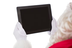 Santa claus using tablet pc Stock Photos