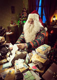 Santa Claus using a vintage calculator Royalty Free Stock Images
