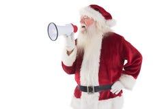 Santa Claus utilise un mégaphone Images stock