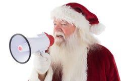 Santa Claus utilise un mégaphone Photos libres de droits