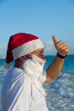 Santa claus on vacation stock photos