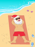 Santa Claus vacation on the beach Stock Images