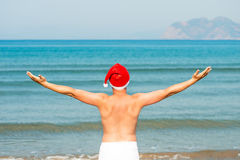 Santa claus on vacation at sea enjoying freedom Stock Images