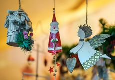 Santa Claus and Xmas decorations in Vilnius Christmas Bazaar. Santa Claus and various Xmas tree decorations as gift souvenirs at one of the many stalls in the stock images