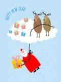 Santa Claus viene abajo en una cuerda y da un regalo Ciervos en la nube Imágenes de archivo libres de regalías
