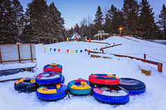Santa Claus` Village, Val-David, Quebec, Canada - January 1, 2017: Snow tubing slide in Santa Claus village in winter. Royalty Free Stock Photos