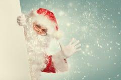 Santa Claus vinkande hälsningar Arkivbild