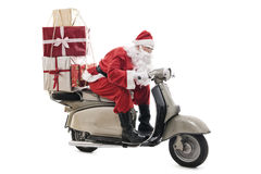 Santa Claus on vintage scooter Royalty Free Stock Photography