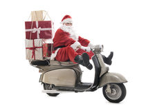 Santa Claus on vintage scooter Royalty Free Stock Image