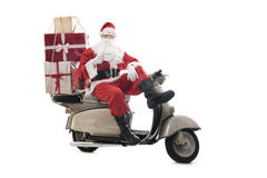 Santa Claus on vintage scooter Stock Image