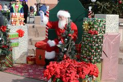 Free Santa Claus Visiting With Local Families Stock Photography - 106185152