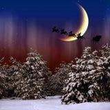 Santa Claus vliegt in de Kerstnacht Stock Foto's