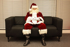 Santa Claus waiting for christmas job Royalty Free Stock Image