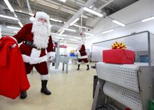 Santa claus waiting for present in factory Royalty Free Stock Photos
