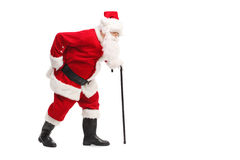 Santa Claus walking with a cane Stock Photography