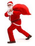 Santa claus walking with full bag Stock Photography