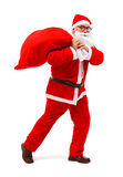 Santa claus walking with full bag Stock Photos