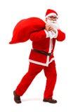 Santa claus walking with full bag Stock Photos