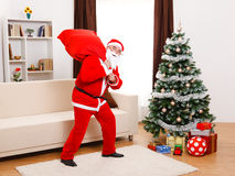 Santa Claus walking with full bag Royalty Free Stock Photography