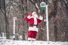 Santa Claus walking with sack on back Royalty Free Stock Photo