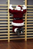 Santa claus on wall bars Stock Photo