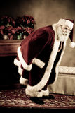 Santa Claus Warming backside Royalty Free Stock Image