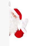 Santa Claus waving with blank sign Stock Images