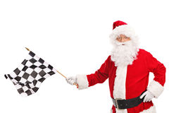 Santa Claus waving a checkered race flag Royalty Free Stock Photo
