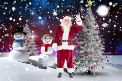 Santa claus waving his hand during christmas time Royalty Free Stock Photos
