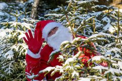 Santa Claus waving with his hand Royalty Free Stock Images